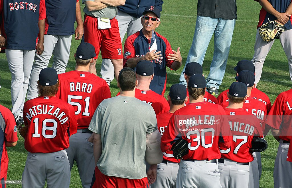 Today was the first official workout for Red Sox pitchers and catchers, and before they took the fields, manager Bobby Valentine, top, gathered everyone together and addressed the players and coaches, including John Lackey, in the grey T-shirt with his arm wrapped in ice. The Boston Red Sox are conducting Spring Training workouts at the team's new 106 acre Spring Training and Player Development Complex known as 'JetBlue Park at Fenway South.'