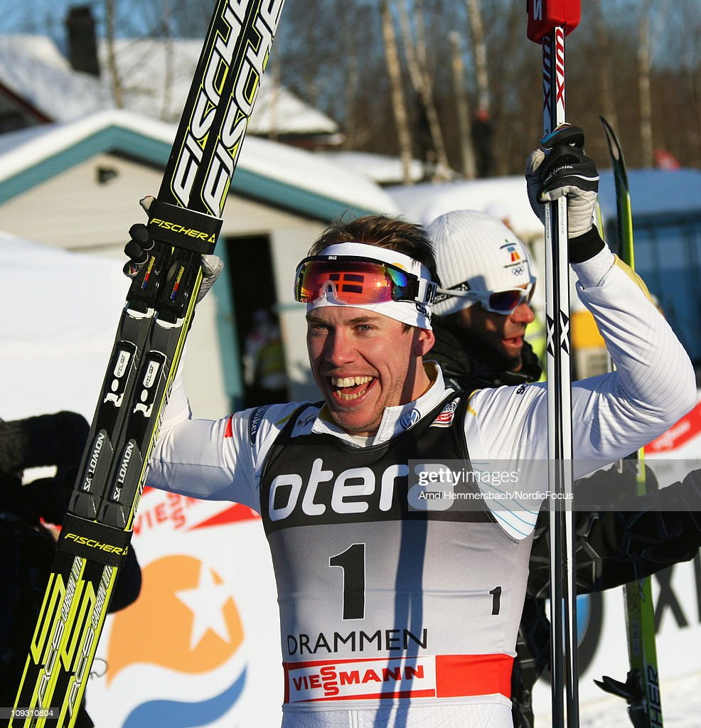 Todays winner <a gi-track='captionPersonalityLinkClicked' href=/galleries/search?phrase=Emil+Joensson&family=editorial&specificpeople=4045550 ng-click='$event.stopPropagation()'>Emil Joensson</a> of Sweden celebrates his victory after the men's individual sprint of the FIS World Cup Cross Country on February 20, 2011 in Drammen, Norway.