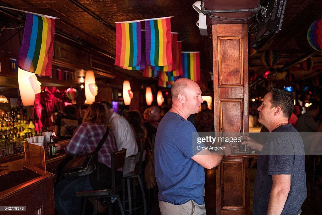 Todd Andrepont-Aycock and his husband Martin Andrepont-Aycock have drinks at the Stonewall Inn on June 24, 2016 in New York City. President Barack Obama designated the Stonewall Inn and approximately 7.7 acres surrounding it as the first national monument dedicated 'to tell the story of the struggle for LGBT rights.' The tavern is considered the birthplace of the modern gay rights movement, where patrons fought back against police persecution in 1969.
