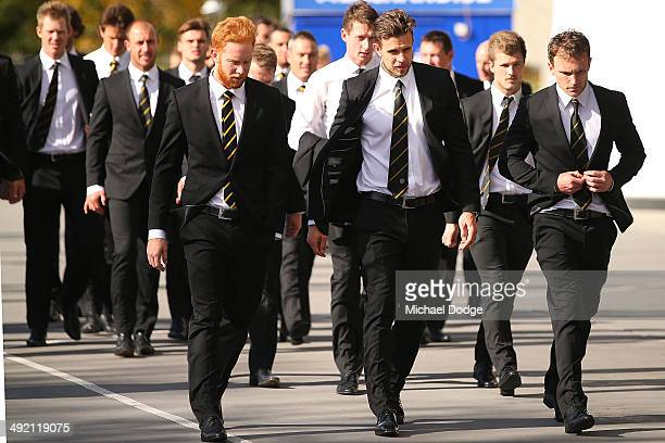 Todd Banfield Brett Deledio and Nathan Foley of the Tigers arrive during the public service for Tom Hafey at Melbourne Cricket Ground on May 19 2014...