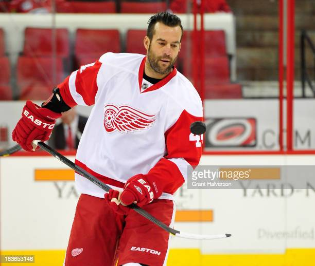 Todd Bertuzzi of the Detroit Red Wings against the Carolina Hurricanes during play at PNC Arena on October 4 2013 in Raleigh North Carolina The Red...