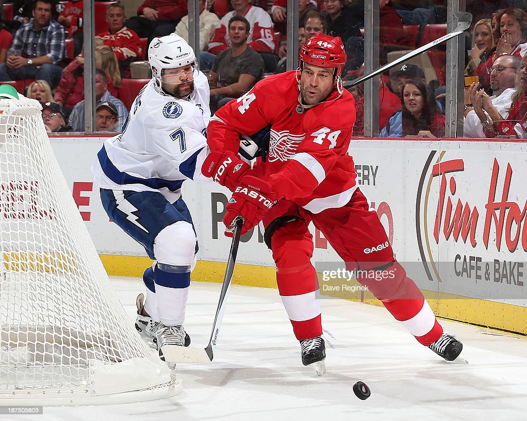 <a gi-track='captionPersonalityLinkClicked' href=/galleries/search?phrase=Todd+Bertuzzi&family=editorial&specificpeople=202476 ng-click='$event.stopPropagation()'>Todd Bertuzzi</a> #44 of the Detroit Red Wings and <a gi-track='captionPersonalityLinkClicked' href=/galleries/search?phrase=Radko+Gudas&family=editorial&specificpeople=5648763 ng-click='$event.stopPropagation()'>Radko Gudas</a> #7 of the Tampa Bay Lightning battle for the puck behind the net during an NHL game at Joe Louis Arena on November 9, 2013 in Detroit, Michigan.