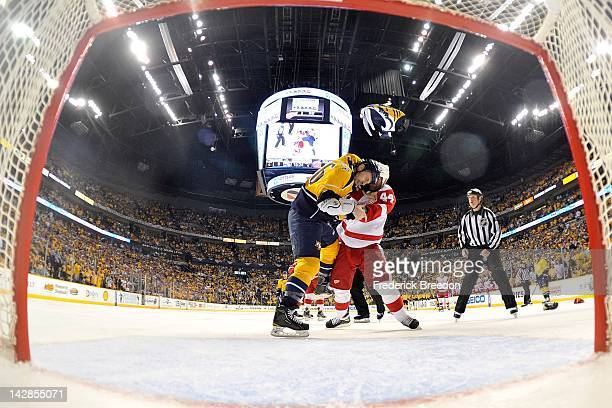 Todd Bertuzzi of the Detroit Red Wings and Shea Weber of the Nashville Predators fight in Game Two of the Western Conference Quarterfinals during the...