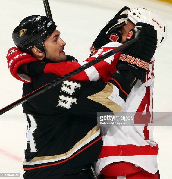 Todd Bertuzzi of the Detroit Red Wings battles for position against Sheldon Souray of the Anaheim Ducks in Game Seven of the Western Conference...