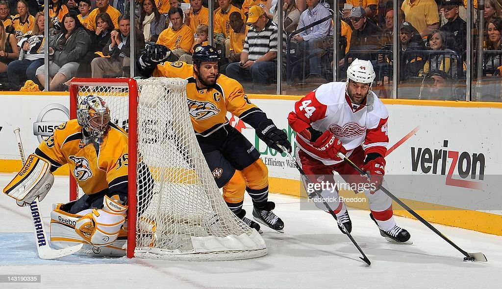 <a gi-track='captionPersonalityLinkClicked' href=/galleries/search?phrase=Todd+Bertuzzi&family=editorial&specificpeople=202476 ng-click='$event.stopPropagation()'>Todd Bertuzzi</a> #44 of the Detroit Red Wings carries the puck past <a gi-track='captionPersonalityLinkClicked' href=/galleries/search?phrase=Shea+Weber&family=editorial&specificpeople=554412 ng-click='$event.stopPropagation()'>Shea Weber</a> #6 of the Nashville Predators and behind the net of goalie <a gi-track='captionPersonalityLinkClicked' href=/galleries/search?phrase=Pekka+Rinne&family=editorial&specificpeople=2118342 ng-click='$event.stopPropagation()'>Pekka Rinne</a> #35 in Game Five of the Western Conference Quarterfinals during the 2012 NHL Stanley Cup Playoffs at the Bridgestone Arena on April 20, 2012 in Nashville, Tennessee.