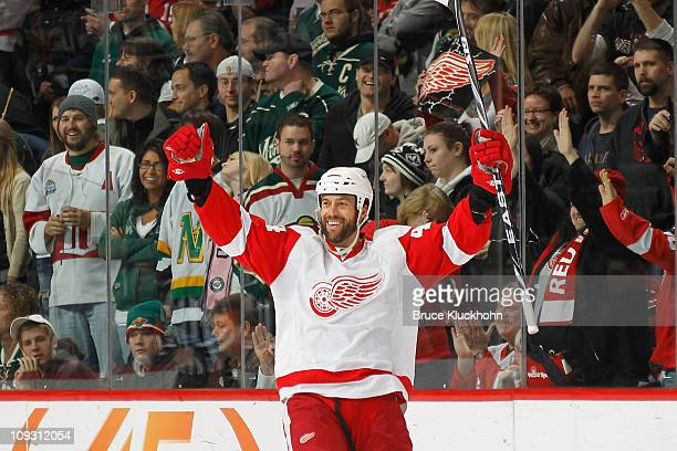 Todd Bertuzzi of the Detroit Red Wings celebrates after scoring the game winning goal in an overtime shootout against the Minnesota Wild during his...