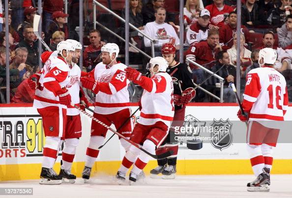 Todd Bertuzzi of the Detroit Red Wings celebrates with Nicklas Lidstrom Johan Franzen Pavel Datsyuk and Ian White after Bertuzzi scored a second...