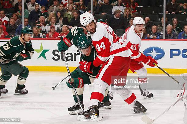 Todd Bertuzzi of the Detroit Red Wings defends Mikael Granlund of the Minnesota Wild during the game on March 22 2014 at the Xcel Energy Center in St...