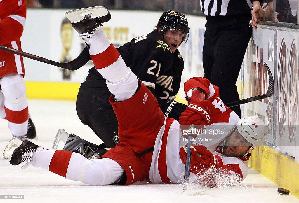 <a gi-track='captionPersonalityLinkClicked' href=/galleries/search?phrase=Todd+Bertuzzi&family=editorial&specificpeople=202476 ng-click='$event.stopPropagation()'>Todd Bertuzzi</a> #44 of the Detroit Red Wings falls while skating the puck against <a gi-track='captionPersonalityLinkClicked' href=/galleries/search?phrase=Loui+Eriksson&family=editorial&specificpeople=2235241 ng-click='$event.stopPropagation()'>Loui Eriksson</a> #21 of the Dallas Stars at American Airlines Center on January 17, 2012 in Dallas, Texas.