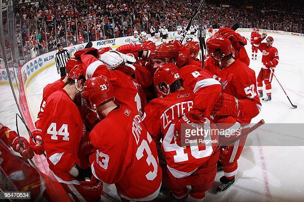 Todd Bertuzzi of the Detroit Red Wings is mobbed by teammates after his overtime game winning goal after a NHL game against the Anaheim Ducks at Joe...