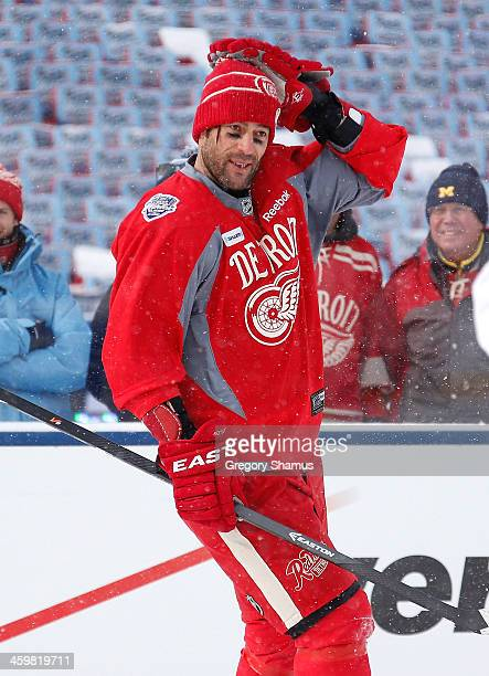 Todd Bertuzzi of the Detroit Red Wings looks on at practice during 2014 Bridgestone NHL Winter Classic at Michigan Stadium on December 31 2013 in Ann...
