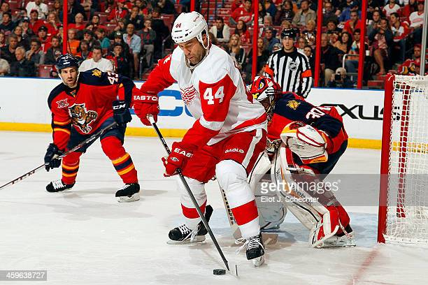 Todd Bertuzzi of the Detroit Red Wings moves the puck against the Florida Panthers at the BBT Center on December 28 2013 in Sunrise Florida