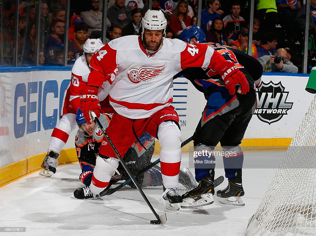 <a gi-track='captionPersonalityLinkClicked' href=/galleries/search?phrase=Todd+Bertuzzi&family=editorial&specificpeople=202476 ng-click='$event.stopPropagation()'>Todd Bertuzzi</a> #44 of the Detroit Red Wings plays the puck behind the net against the New York Islanders at Nassau Veterans Memorial Coliseum on November 16, 2013 in Uniondale, New York.