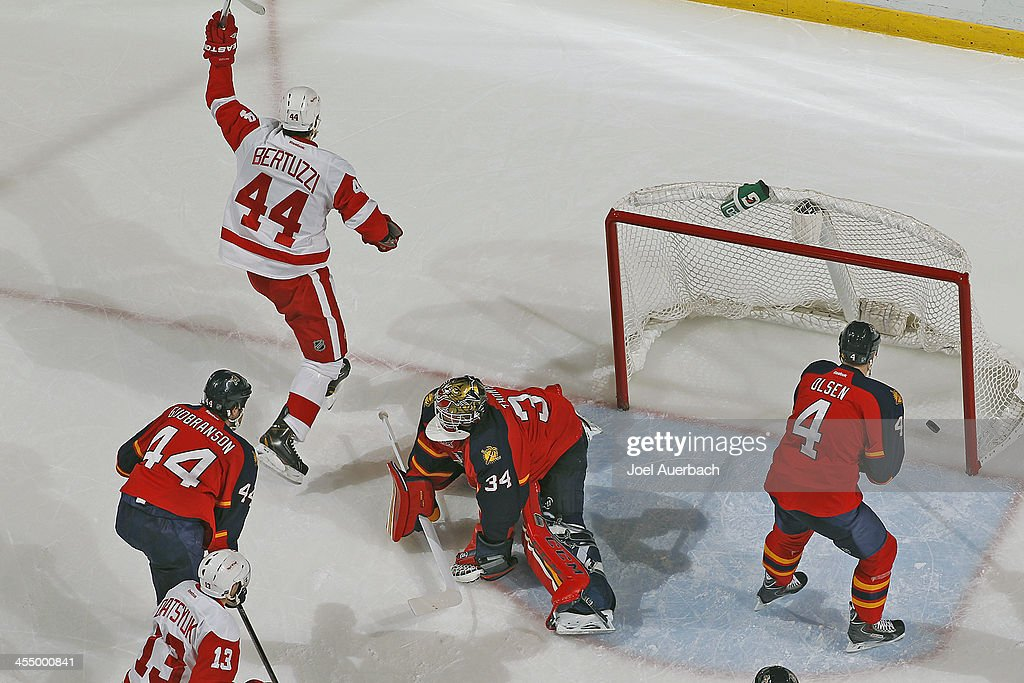 <a gi-track='captionPersonalityLinkClicked' href=/galleries/search?phrase=Todd+Bertuzzi&family=editorial&specificpeople=202476 ng-click='$event.stopPropagation()'>Todd Bertuzzi</a> #44 of the Detroit Red Wings raises his stick in celebration of scoring a first period goal against goaltender Tim Thomas #34 of the Florida Panthers at the BB&T Center on December 10, 2013 in Sunrise, Florida. The Panthers defeated the red Wings 3-2 in a shootout.