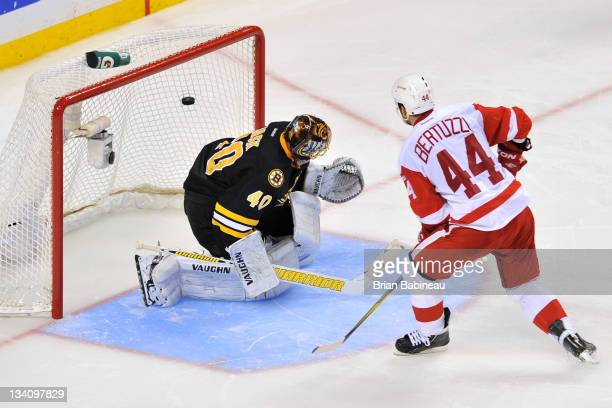 Todd Bertuzzi of the Detroit Red Wings scores a goal to win in the shoot out against Tuukka Rask of the Boston Bruins at the TD Garden on November 25...