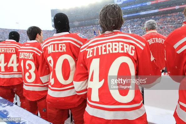 Todd Bertuzzi Pavel Datsyuk Drew Miller and Henrik Zetterberg of the Detroit Red Wings stand for the National Anthem before the Bridgestone NHL...