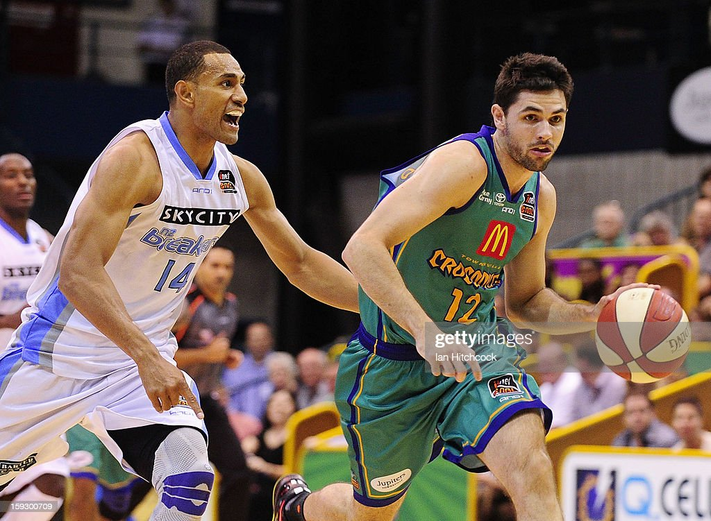 Todd Blachfield of the Crocodiles drives to the basket past Mika Vukona of the Breakers during the round 14 NBL match between the TOwnsville Crocodiles and the New Zealand Breakers at Townsville Entertainment Centre on January 11, 2013 in Townsville, Australia.