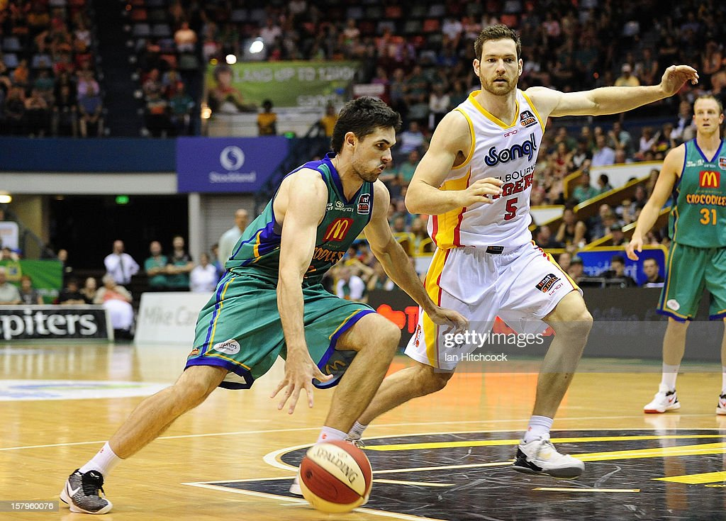 Todd Blanchfield of the Crocodiles drives past Tommy Greer of the Tigers during the round ten NBL match between the Townsville Crocodiles and the Melbourne Tigers at Townsville Entertainment Centre on December 8, 2012 in Townsville, Australia.