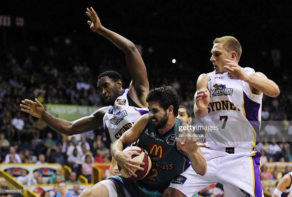 Todd Blanchfield of the Crocodiles is blocked by Darnell Lazare and Graeme Dann of the Kings during the round 17 NBL match between the Townsville Crodcodiles and the Sydney Kings at Townsville Entertainment Centre on February 2, 2013 in Townsville, Australia.