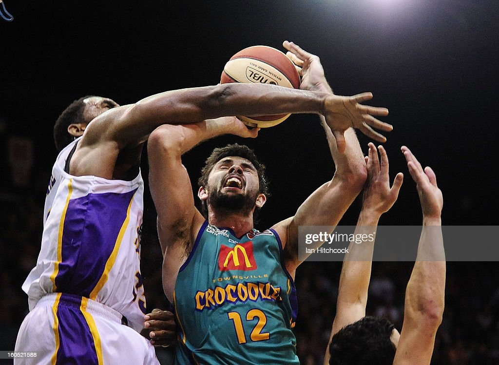 Todd Blanchfield of the Crocodiles is blocked by Darnell Lazare of the Kings during the round 17 NBL match between the Townsville Crodcodiles and the Sydney Kings at Townsville Entertainment Centre on February 2, 2013 in Townsville, Australia.