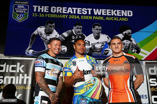 Todd Carney of the Cronulla Sharks Willie Tonga of the Parramatta Eels and Robbie Farah of the Wests Tigers pose with the NRL Auckland Nines trophy...