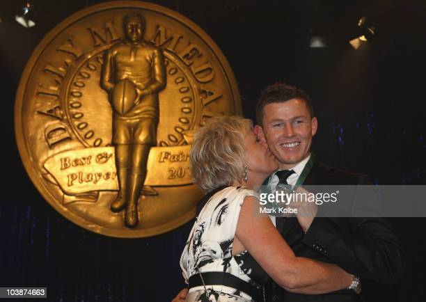 Todd Carney receives a kiss from his mother Leanne Carney as he poses with the Dally M medal at the 2010 Dally M Awards at the State Theatre on...