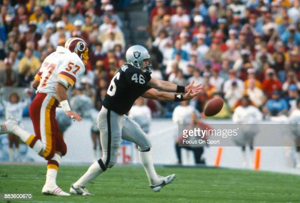 Todd Christensen of the Los Angeles Raiders can't make the catch while defended by Rich Milot of the Washington Redskins during Super Bowl XVIII on...