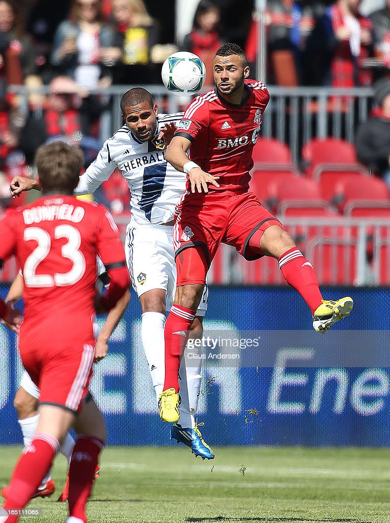 Todd Dunivan #2 of the Los Angeles Galaxy goes up for a ball against John Bostock #7 of the Toronto FC in an MLS game on March 30, 2013 at BMO Field in Toronto, Ontario, Canada.