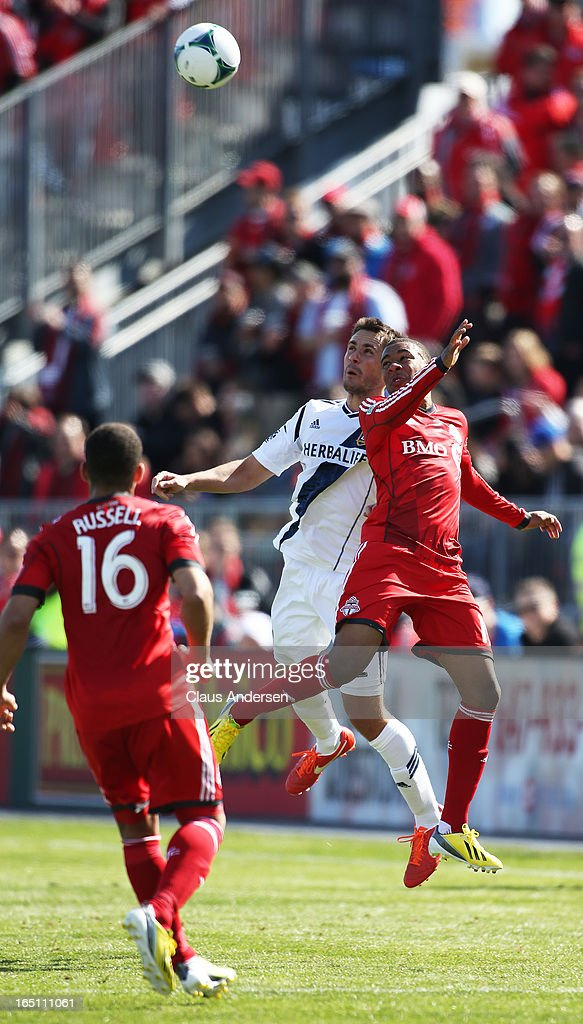 Todd Dunivant #2 of the Los Angeles Galaxy goes up for a ball against <a gi-track='captionPersonalityLinkClicked' href=/galleries/search?phrase=Robert+Earnshaw&family=editorial&specificpeople=208190 ng-click='$event.stopPropagation()'>Robert Earnshaw</a> #10 of the Toronto FC in an MLS game on March 30, 2013 at BMO Field in Toronto, Ontario, Canada. The Los Angeles Galaxy and Toronto FC played to a 2-2 tie.