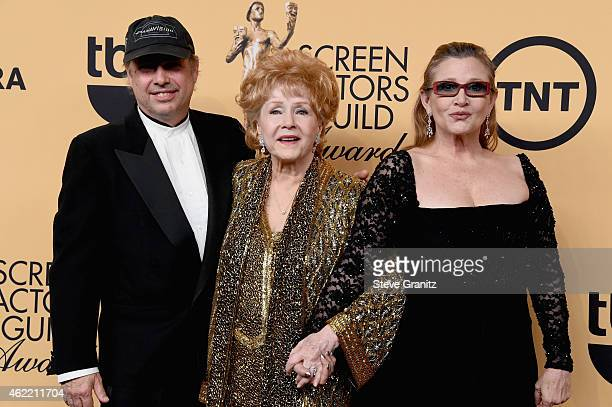 Todd Fisher honoree Debbie Reynolds and actress Carrie Fisher pose in the press room at the 21st Annual Screen Actors Guild Awards at The Shrine...