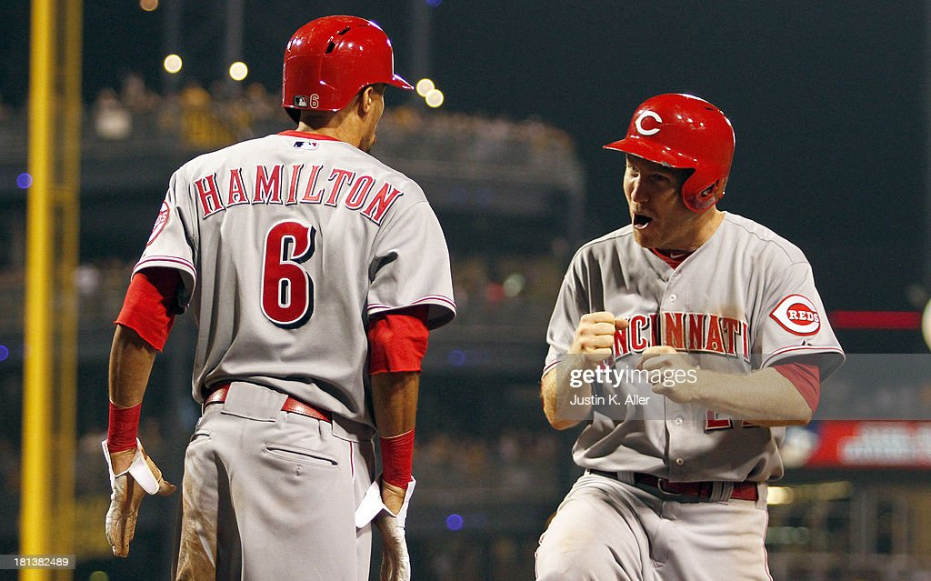 <a gi-track='captionPersonalityLinkClicked' href=/galleries/search?phrase=Todd+Frazier&family=editorial&specificpeople=4778756 ng-click='$event.stopPropagation()'>Todd Frazier</a> #21 and Billy Hamilton #6 of the Cincinnati Reds celebrate after scoring to tie the game in the ninth inning against the Pittsburgh Pirates during the game on September 20, 2013 at PNC Park in Pittsburgh, Pennsylvania.