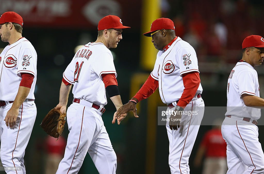 <a gi-track='captionPersonalityLinkClicked' href=/galleries/search?phrase=Todd+Frazier&family=editorial&specificpeople=4778756 ng-click='$event.stopPropagation()'>Todd Frazier</a> #21 and <a gi-track='captionPersonalityLinkClicked' href=/galleries/search?phrase=Dusty+Baker&family=editorial&specificpeople=202908 ng-click='$event.stopPropagation()'>Dusty Baker</a> the manager of the Cincinnati Reds celebrate after the game against the St. Louis Cardinals at Great American Ball Park on September 5, 2013 in Cincinnati, Ohio.