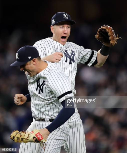 Todd Frazier and Greg Bird of the New York Yankees celebrate after defeating the Houston Astros by a score of 64 to win Game Four of the American...