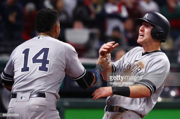 Todd Frazier celebrates with Starlin Castro of the New York Yankees after scoring on a single by Brett Gardner in the ninth inning against the...