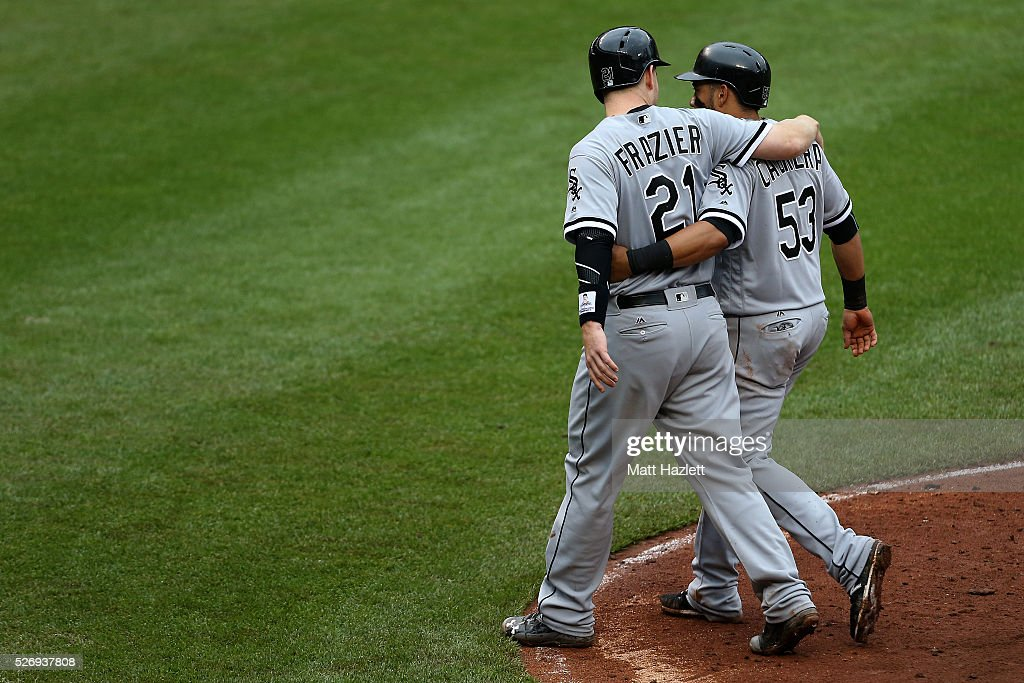 Todd Frazier #21 of the Chicago White Sox and Melky Cabrera #53 of the Chicago White Sox celebrate after scoring off a hit by Jerry Sands (not pictured) #41 of the Chicago White Sox in the fifth inning against the Baltimore Orioles at Oriole Park at Camden Yards on May 1, 2016 in Baltimore, Maryland.