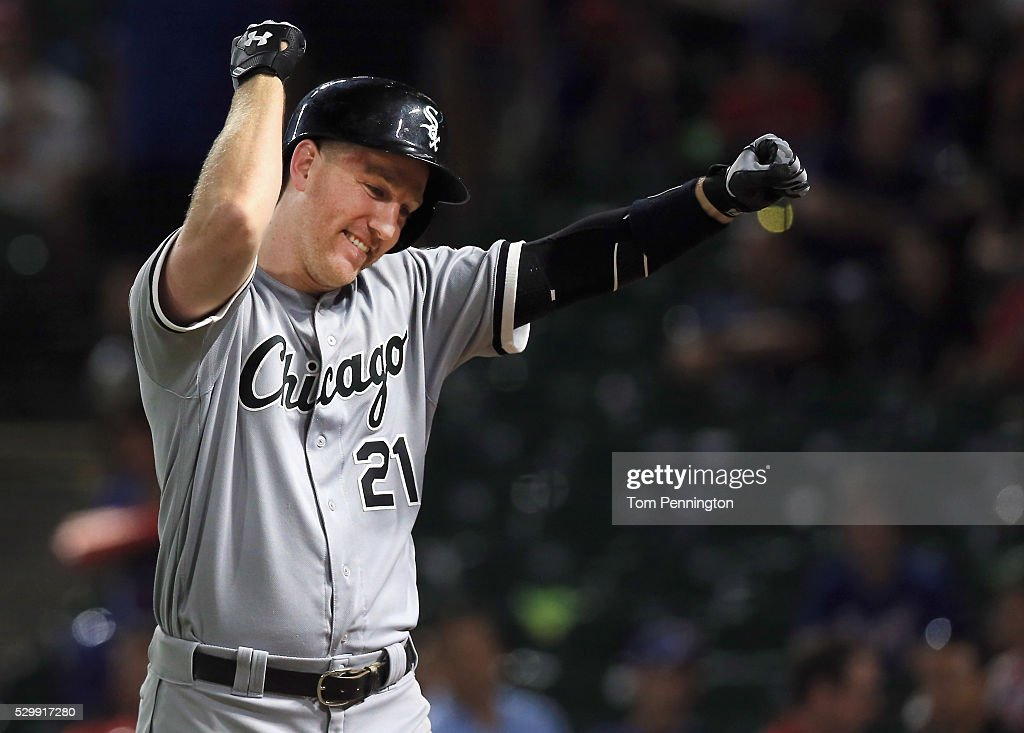 Todd Frazier of the Chicago White Sox celebrates after hitting a grand slam home run in against the Texas Rangers in the top of the twelfth inning at...