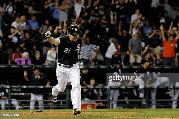 Todd Frazier of the Chicago White Sox celebrates after hitting a wlakoff RBI single against the Seattle Mariners to score Adam Eaton in their win at...