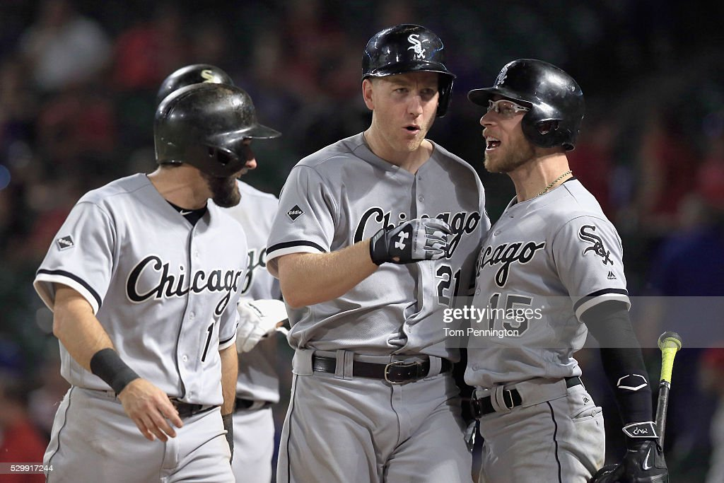 Todd Frazier #21 of the Chicago White Sox celebrates with Adam Eaton #1 of the Chicago White Sox and Brett Lawrie #15 of the Chicago White Sox after hitting a grand slam home run against the Texas Rangers in the top of the twelfth inning at Globe Life Park in Arlington on May 9, 2016 in Arlington, Texas.