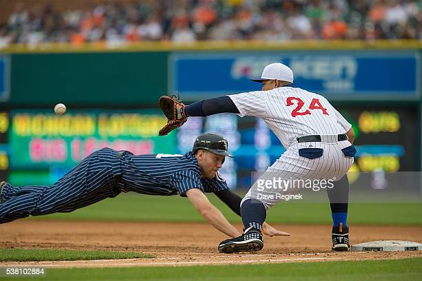Todd Frazier of the Chicago White Sox dives back to first base as Miguel Cabrera of the Detroit Tigers reaches for the throw in the fifth inning...