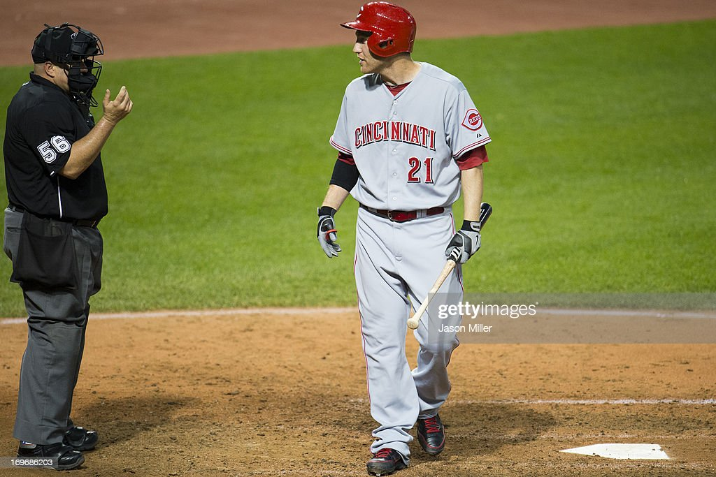 <a gi-track='captionPersonalityLinkClicked' href=/galleries/search?phrase=Todd+Frazier&family=editorial&specificpeople=4778756 ng-click='$event.stopPropagation()'>Todd Frazier</a> #21 of the Cincinnati Reds argues a call with home plate umpire Eric Cooper #56 after Frazier struck out during the sixth inning against the Cleveland Indians at Progressive Field on May 30, 2013 in Cleveland, Ohio. The Indians defeated the Reds 7-1.
