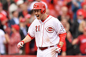 Todd Frazier of the Cincinnati Reds celebrates as he crosses home plate after hitting a threerun home run in the eighth inning against the Pittsburgh...