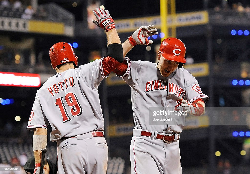 Todd Frazier of the Cincinnati Reds celebrates his game winning solo home run with Joey Votto during the ninth inning against the Pittsburgh Pirates...