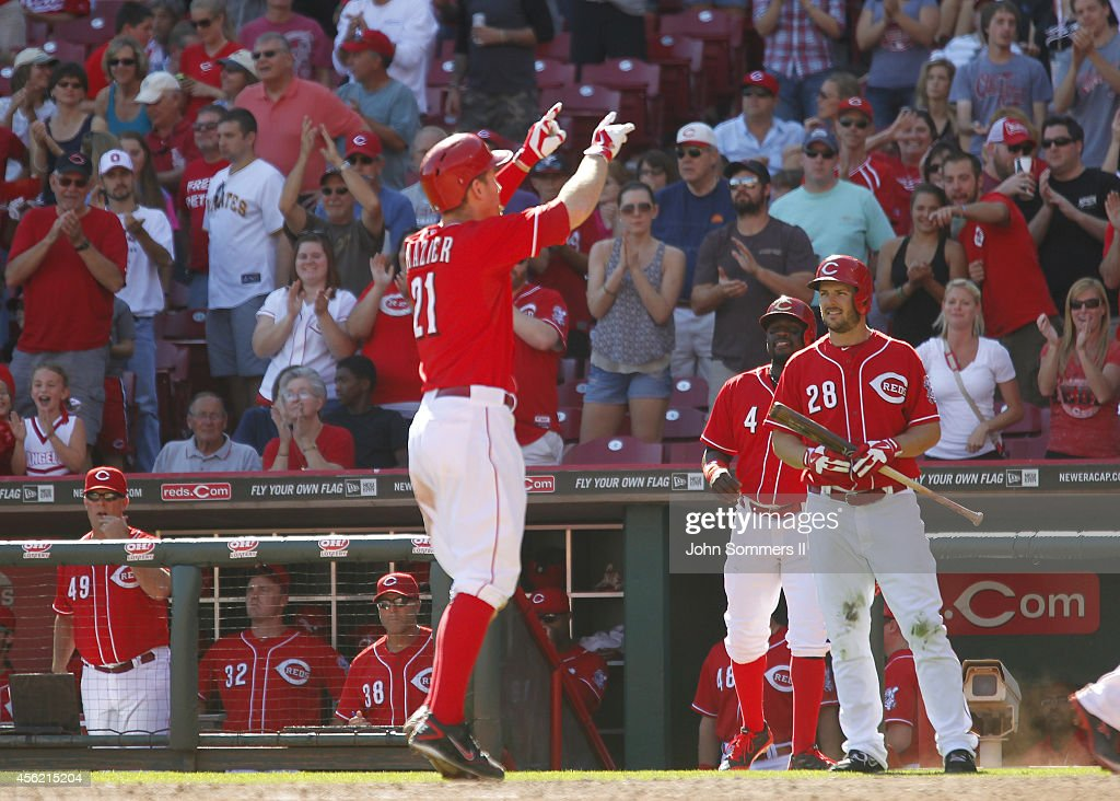 Todd Frazier #21 of the Cincinnati Reds celebrates his home run against the Pittsburgh Pirates at Great American Ball Park on September 27, 2014 in Cincinnati, Ohio.