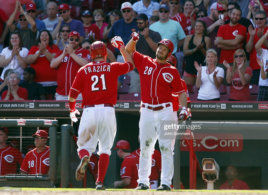 Todd Frazier #21 of the Cincinnati Reds celebrates his home run with Chris Heisey #21 against the Pittsburgh Pirates at Great American Ball Park on September 27, 2014 in Cincinnati, Ohio.