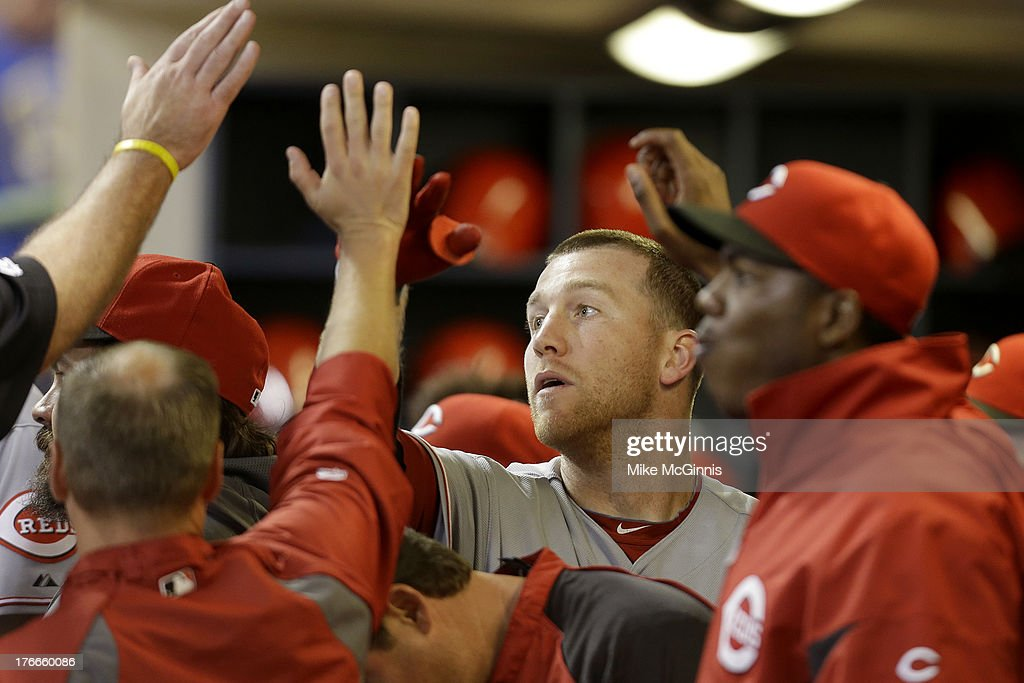 <a gi-track='captionPersonalityLinkClicked' href=/galleries/search?phrase=Todd+Frazier&family=editorial&specificpeople=4778756 ng-click='$event.stopPropagation()'>Todd Frazier</a> #21 of the Cincinnati Reds celebrates in the dugout after hitting a solo home run in the top of the fourth inning against the Milwaukee Brewers at Miller Park on August 16, 2013 in Milwaukee, Wisconsin.