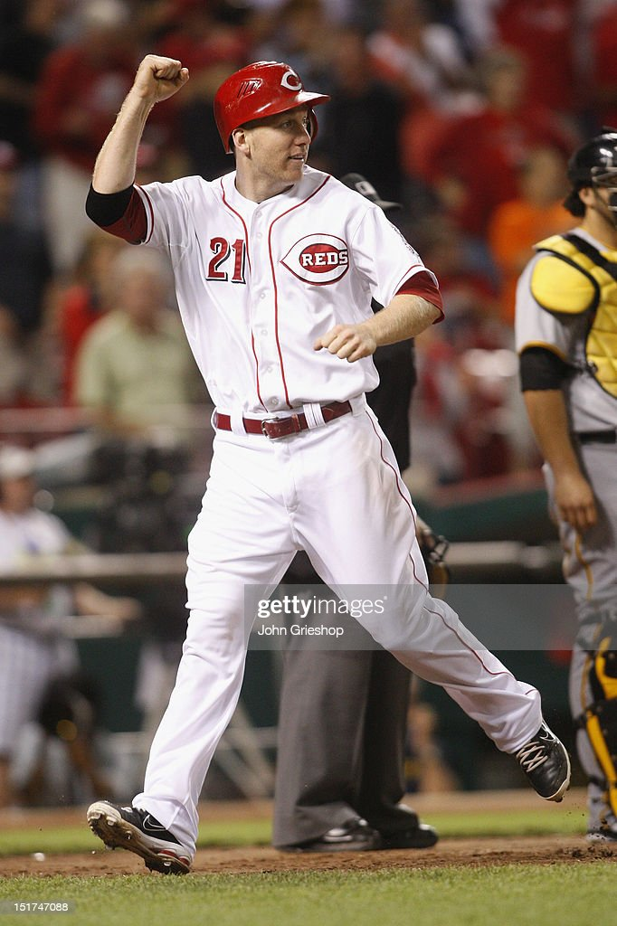 <a gi-track='captionPersonalityLinkClicked' href=/galleries/search?phrase=Todd+Frazier&family=editorial&specificpeople=4778756 ng-click='$event.stopPropagation()'>Todd Frazier</a> #21 of the Cincinnati Reds celebrates scoring a run during the game against the Pittsburgh Pirates at Great American Ball Park on September 10, 2012 in Cincinnati, Ohio. The Reds defeated the Pirates 4-3 in 14 innings.