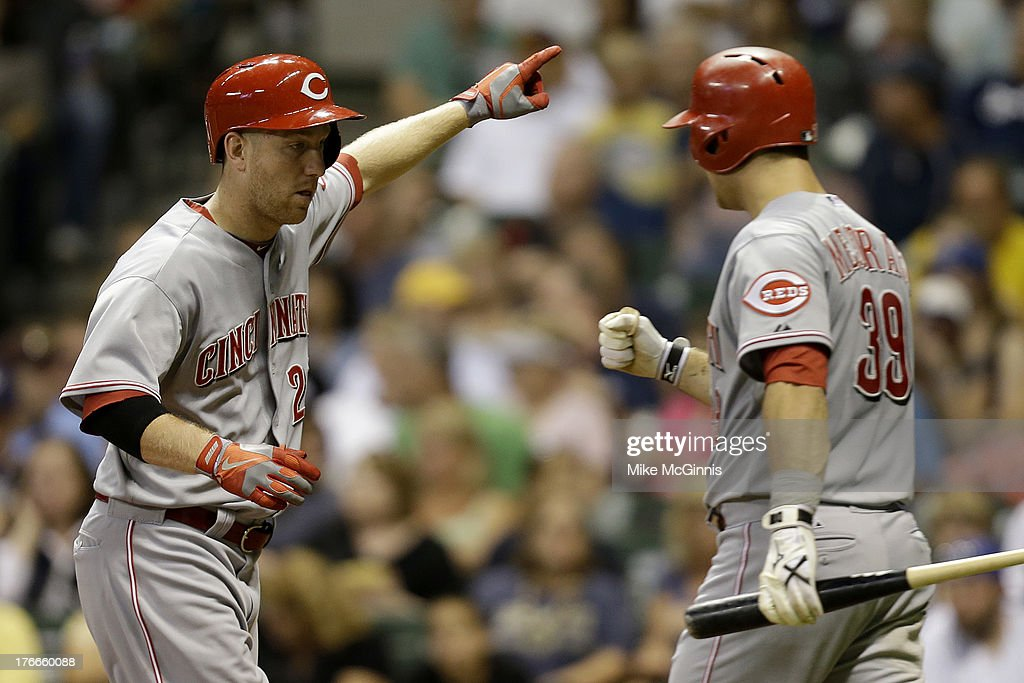 <a gi-track='captionPersonalityLinkClicked' href=/galleries/search?phrase=Todd+Frazier&family=editorial&specificpeople=4778756 ng-click='$event.stopPropagation()'>Todd Frazier</a> #21 of the Cincinnati Reds celebrates with <a gi-track='captionPersonalityLinkClicked' href=/galleries/search?phrase=Devin+Mesoraco&family=editorial&specificpeople=5745587 ng-click='$event.stopPropagation()'>Devin Mesoraco</a> #39 after hitting a solo home run in the top of the fourth inning against the Milwaukee Brewers at Miller Park on August 16, 2013 in Milwaukee, Wisconsin.
