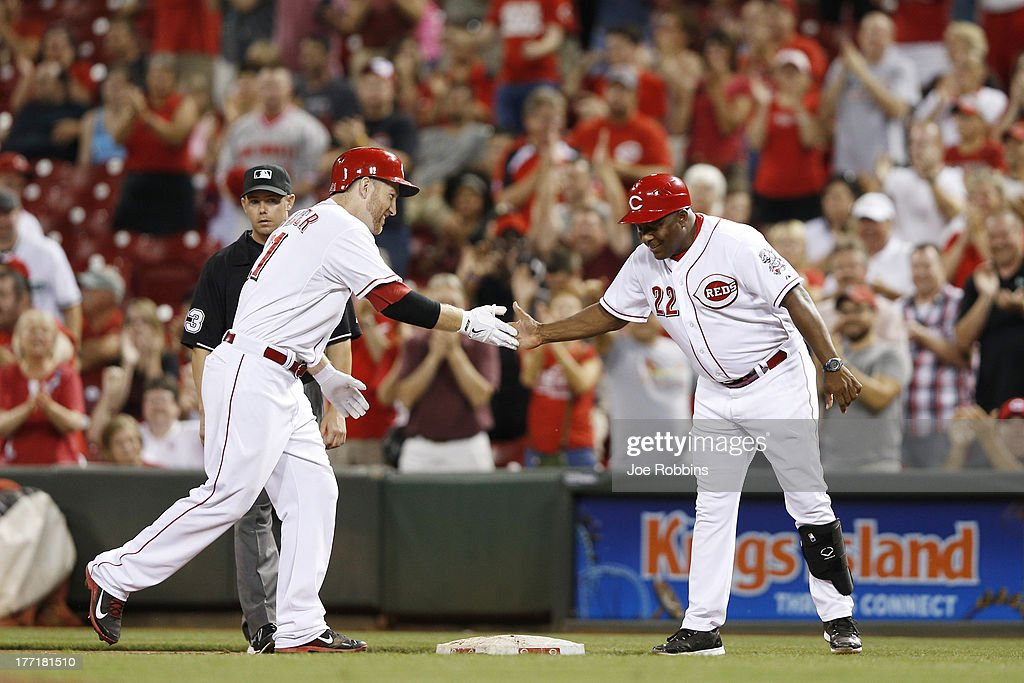 <a gi-track='captionPersonalityLinkClicked' href=/galleries/search?phrase=Todd+Frazier&family=editorial&specificpeople=4778756 ng-click='$event.stopPropagation()'>Todd Frazier</a> #21 of the Cincinnati Reds celebrates with first base coach Billy Hatcher after driving in a run in the eighth inning of the game against the Arizona Diamondbacks at Great American Ball Park on August 21, 2013 in Cincinnati, Ohio. The Reds won 10-7.