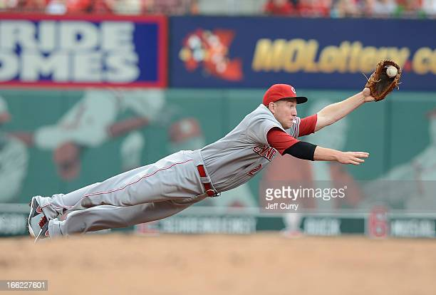 Todd Frazier of the Cincinnati Reds dives and throws out Yadier Molina of the St Louis Cardinals during the second inning at Busch Stadium on April...