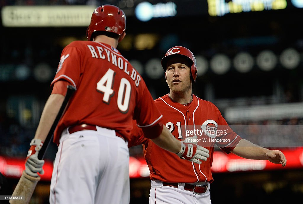 <a gi-track='captionPersonalityLinkClicked' href=/galleries/search?phrase=Todd+Frazier&family=editorial&specificpeople=4778756 ng-click='$event.stopPropagation()'>Todd Frazier</a> #21 of the Cincinnati Reds is congratulated by <a gi-track='captionPersonalityLinkClicked' href=/galleries/search?phrase=Greg+Reynolds+-+Baseball+Player&family=editorial&specificpeople=6889139 ng-click='$event.stopPropagation()'>Greg Reynolds</a> #40 after Frazier scored on a two-run double by Corky Miller #37 in the second inning against the San Francisco Giants at AT&T Park on July 23, 2013 in San Francisco, California.